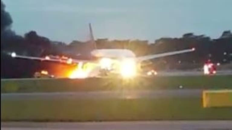 The right wing of the plane erupted in flames after it landed at Changi Airport.