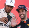 Mercedes driver Lewis Hamilton of Britain takes a selfie with Red Bull driver Daniel Ricciardo, right, of Australia on the podium after winning the Japanese Formula One Grand Prix at Suzuka, Japan, Sunday, Oct. 8, 2017. Ricciardo finished third. (AP Photo/Toru Takahashi)