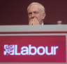 UK Labour leader Jeremy Corbyn listens during the opening speeches at the Labour Party Annual Conference in Brighton on Sunday.