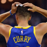 Golden State Warriors guard Stephen Curry has been fined $US50,000 for throwing his mouthguard.