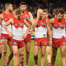 Coach John Longmire says his Swans looked 'buggered' in defeat to Cats