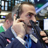 Dow Jones tops 23,000, fuelled by corporate earnings