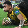 Seizing the moment: Israel Folau shows a look for sheer determination after scoring against the All Blacks.