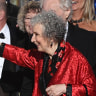 """Elisabeth Moss, left, and author Margaret Atwood embrace as """"The Handmaid's Tale"""" wins the award for outstanding drama series at the 69th Primetime Emmy Awards on Sunday, September 17, 2017, at the Microsoft Theater in Los Angeles."""