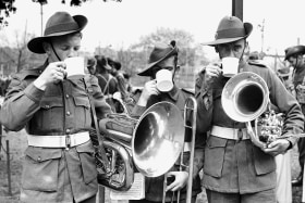 Bandsmen of the A.I.F. drink tea during a break while training at Sydney's Prince Alfred Park in 1942.