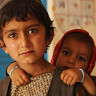 A young boy and his little sister at an Australian-funded health clinic in Oruzgan province.