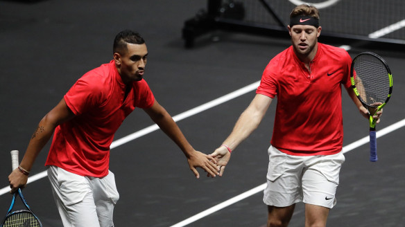 World's Nick Kyrgios, left, and Jack Sock, right, celebrate winning a point against Europe's Rafael Nadal and Tomas Berdych during their Laver Cup doubles tennis match.