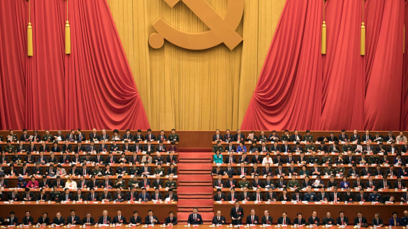 President Xi Jinping, centre, presides over the opening ceremony of the 19th Party Congress.