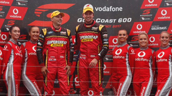 Chaz Mostert and co-driver Steve Owen of Supercheap Auto Racing celebrate winning race 21 of the Vodafone Gold Coast 600 Supercar series in the Gold Coast, Saturday, October 21, 2017. The Vodafone Gold Coast 600 Supercars event is part of the Virgin Australia Supercars Championship.