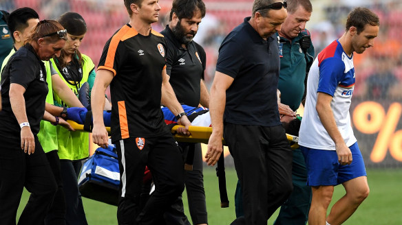 Major blow: Ronald Vargas is stretchered off the field at Suncorp Stadium.