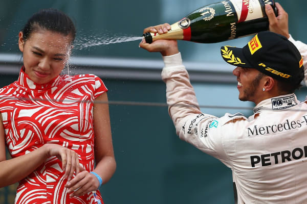 Spraying a podium hostess with champagne? It's sadly just par for the course