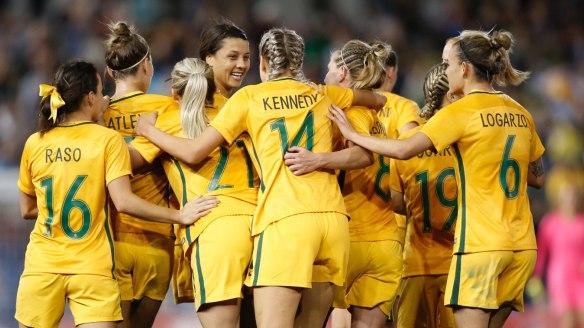 Good as gold: Matildas players celebrate Sam Kerr's first goal on Tuesday.