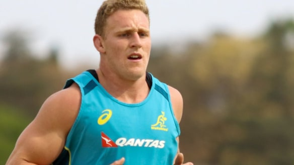 Flexible: Reece Hodge gets some kilometres into his legs at Wallabies training on Monday.