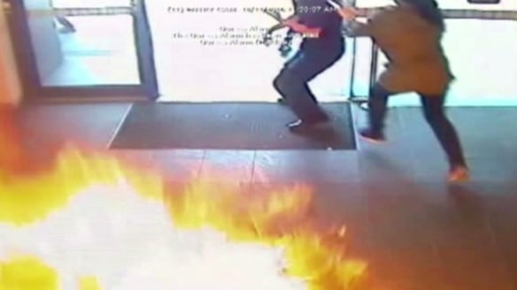 People flee the fireball in the Springvale Commonwealth bank.