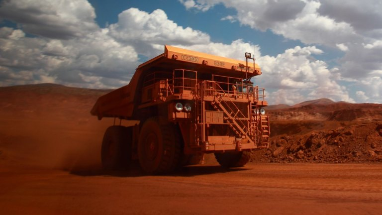 Iron ore surges 5.9pc after BHP Billiton slows growth pace