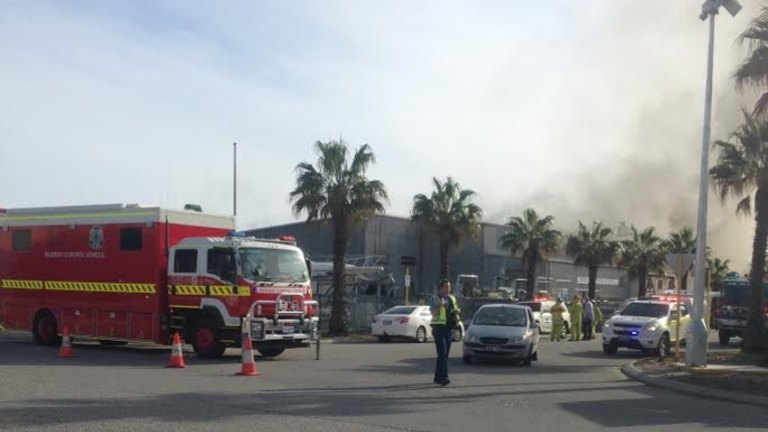 Firefighters rush to blaze at boat maintenance facility in