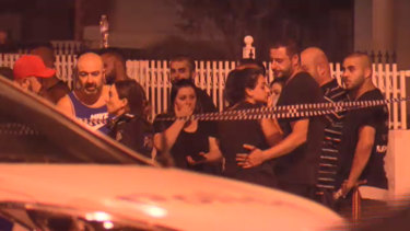 People gather at the Epping scene where underworld figure Nabil Maghnie was gunned down.