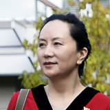 Meng Wanzhou leaves her Vancouver home for a court appearance.