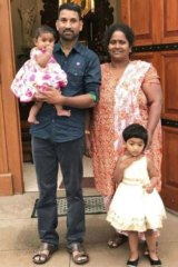 Nadesalingam and Priya with their two children.