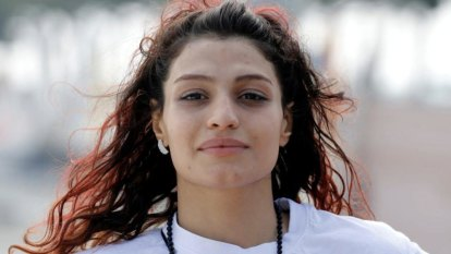 History-making female boxer from Iran cancels return home after arrest warrant issued