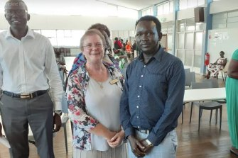 Wallon-based environmentalist and anti-dump campaigner Ursula Monsiegneur is an 2020  Ipswich mayoral candidate. She is pictured here with members of the South Sudanese Christian Church.