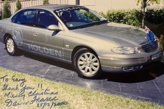 A photo of the Holden car that Gary Merlino used to chauffeur Dawn Fraser in 2000, autographed by the Olympic great.