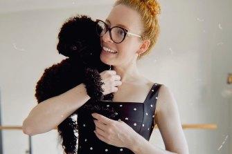 Emma Watkins with her poodle, Rupi.