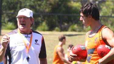 Learning the ropes: Jake Stein with then-GWS Giants coach Kevin Sheedy back in 2012.