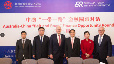 Jean Dong, second from right, was involved in setting up the board that advised on Victoria's Belt and Road deal.