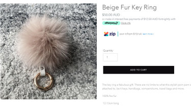 Beige fur key ring tested as fox fur sold at Alexandra Australia without a label.