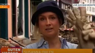 Screen grabs from RTL.de footage of a news report by German TV reporterSusanna Ohlen who was later suspended after being caught allegedly smearing herself with mud.