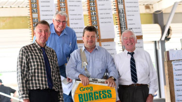 Bookmakers Greg Burgess, far left, and his father Garry Burgess, far right.
