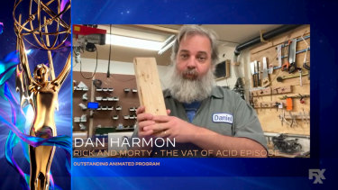 Phoning it in ... Dan Harmon uses a block of wood as an imaginary Emmy during his acceptance speech in 2020.