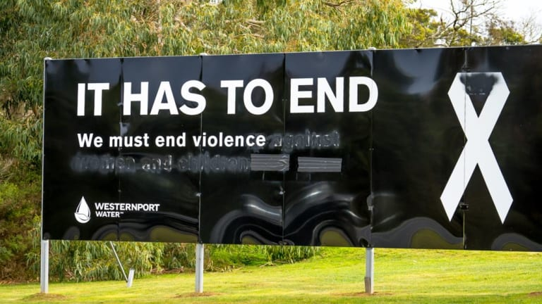 A white ribbon sign on Phillip Island has been vandalised.