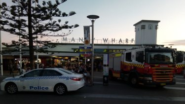 Police and firefighters respond to a threat at Manly Wharf.