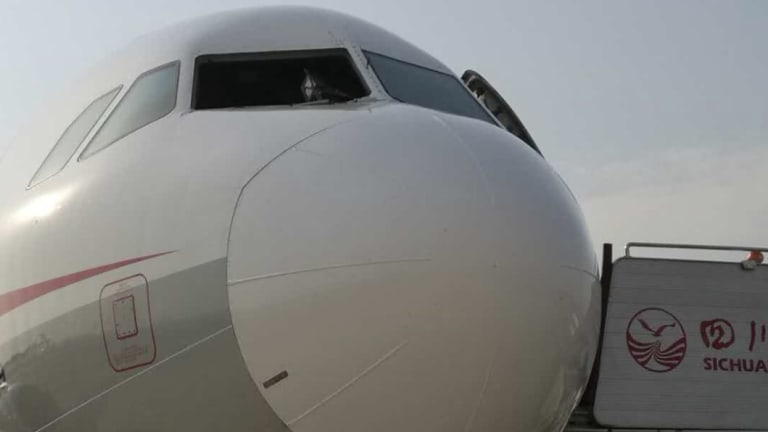 The Sichuan Airlines plane was heading for Tibet when its windshield shattered and a co-pilot was partially sucked out of the cockpit.