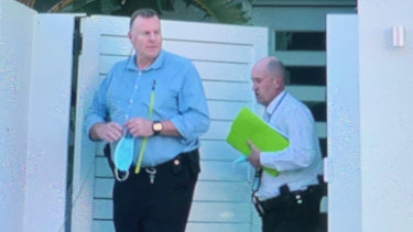 Queensland detectives leave a Palm Beach house owned by Mick Doohan, wherePeter Fox has been staying.