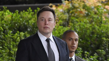 Elon Musk arrives at the US District Court in Los Angeles. He says he is asset rich, but cash poor.