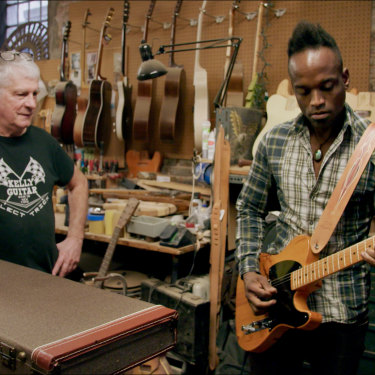 Kelly with The Roots' guitarist Kirk Douglas in the documentary Carmine Street Guitars.