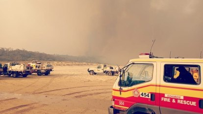 Almost half of Fraser Island burnt despite 1 million litres of water, retardant