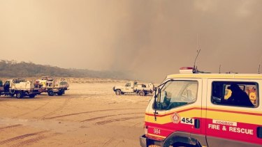 An image shared by QFES on Monday showing the scene on Fraser Island as the bushfire continued to burn.