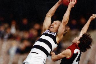 Gary Ablett leaps for a mark.
