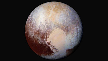 In this combination of images captured by the New Horizons spacecraft and given enhanced colours, the differences in the composition and texture of Pluto's surface can be seen.