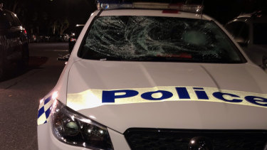One of the damaged police cars.