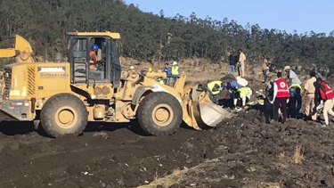 Rescuers use mechanical diggers at the site of an Ethiopian Airlines crash, south of Addis Ababa, in which 157 died.