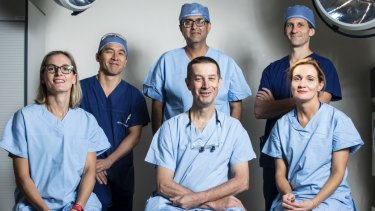 The saviours: (From left to right): Cardiothoracic surgeon Emily Granger, trauma surgeon on call Rohan Gett, urologist Raji Kooner   (behind), general and vascular surgeon Anthony Grabs (front) , anaesthetist Andrew Jackson (behind) and anaesthetist Romaa Steele (front).