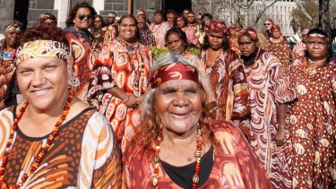 Stars of The Song Keepers, the Central Australian Women's Aboriginal Choir, outside the German Lutheran Trinity Church in Melbourne.