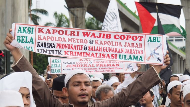 The Palestinian flag (seen here top right) is a common sight at mass protests in Jakarta.