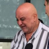 Aya Hishmeh's father was visibly distressed during his daughter's first court appearance the day after the crash.