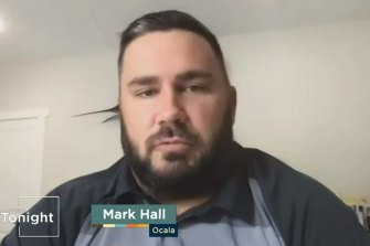 Mark Hall, who was against the COVID-19 vaccine but changed his mind after meeting Dr Duane Mitchell in a bar.
